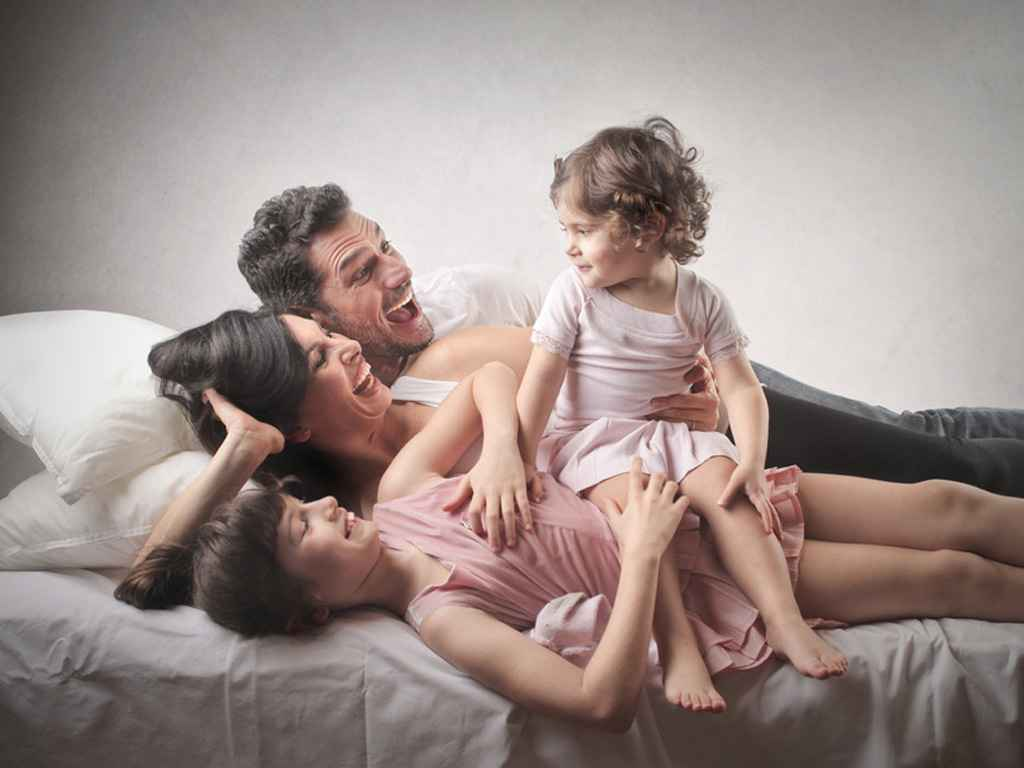 Família feliç amb el pla bucodental